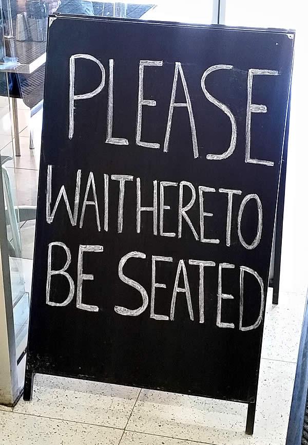 ricardos-seating-sign