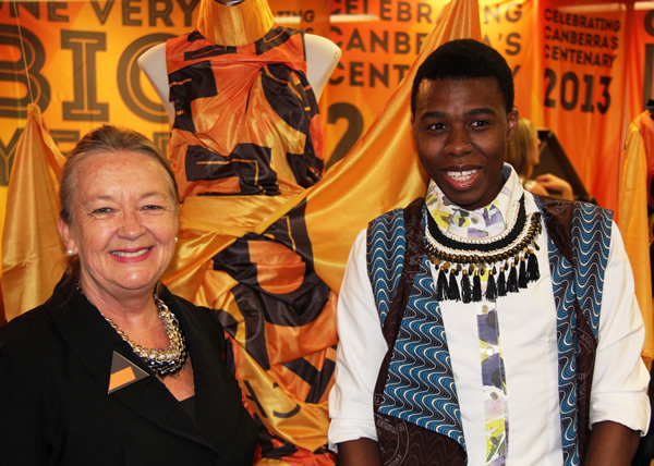 Minister Burch and Reuben Bokaba with his winning entry in the Centenary Flag Project