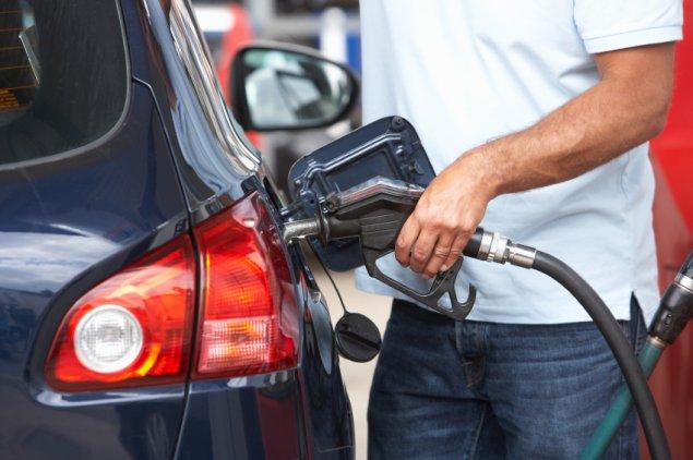 man filling up at petrol station