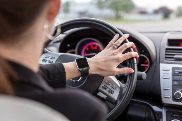 woman driving wearing smart watch