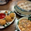 A selection of dishes from Yat Bun Tong: clockwise from top xiaolongbao dumplings; hot and sour soup; and fried dim sims.