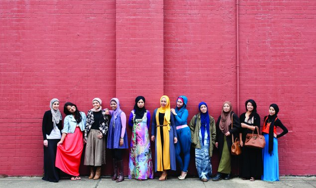 Muslim fashion bloggers Delina Darusman-Gala and Mya Arifin with a group of friends.  Photo: Marinco Kojdanovski  © Museum of Applied Arts and Sciences, Sydney.