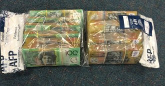 Man on trafficking charge after drugs, cash seized in Belconnen, Gungahlin