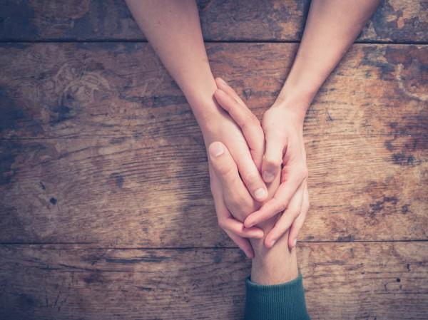 Holding hands. Photo: iStock