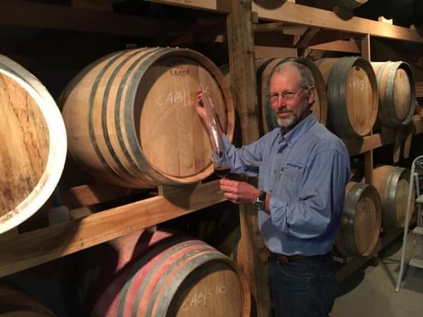 Danny Hansen samples wine in his straw bale cellar. Photo: John Thistleton