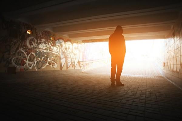 Shadow of man standing in underpass.