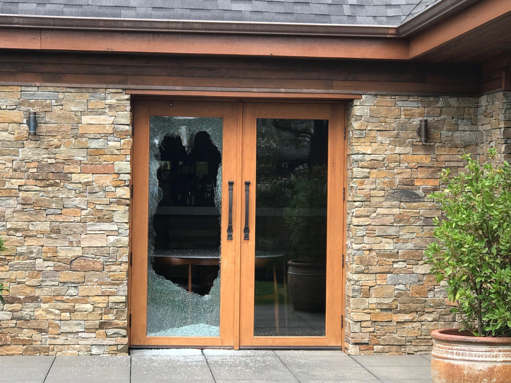 Pialligo Estate Farmhouse with one glass door panel destroyed. Photo: Charlotte Harper