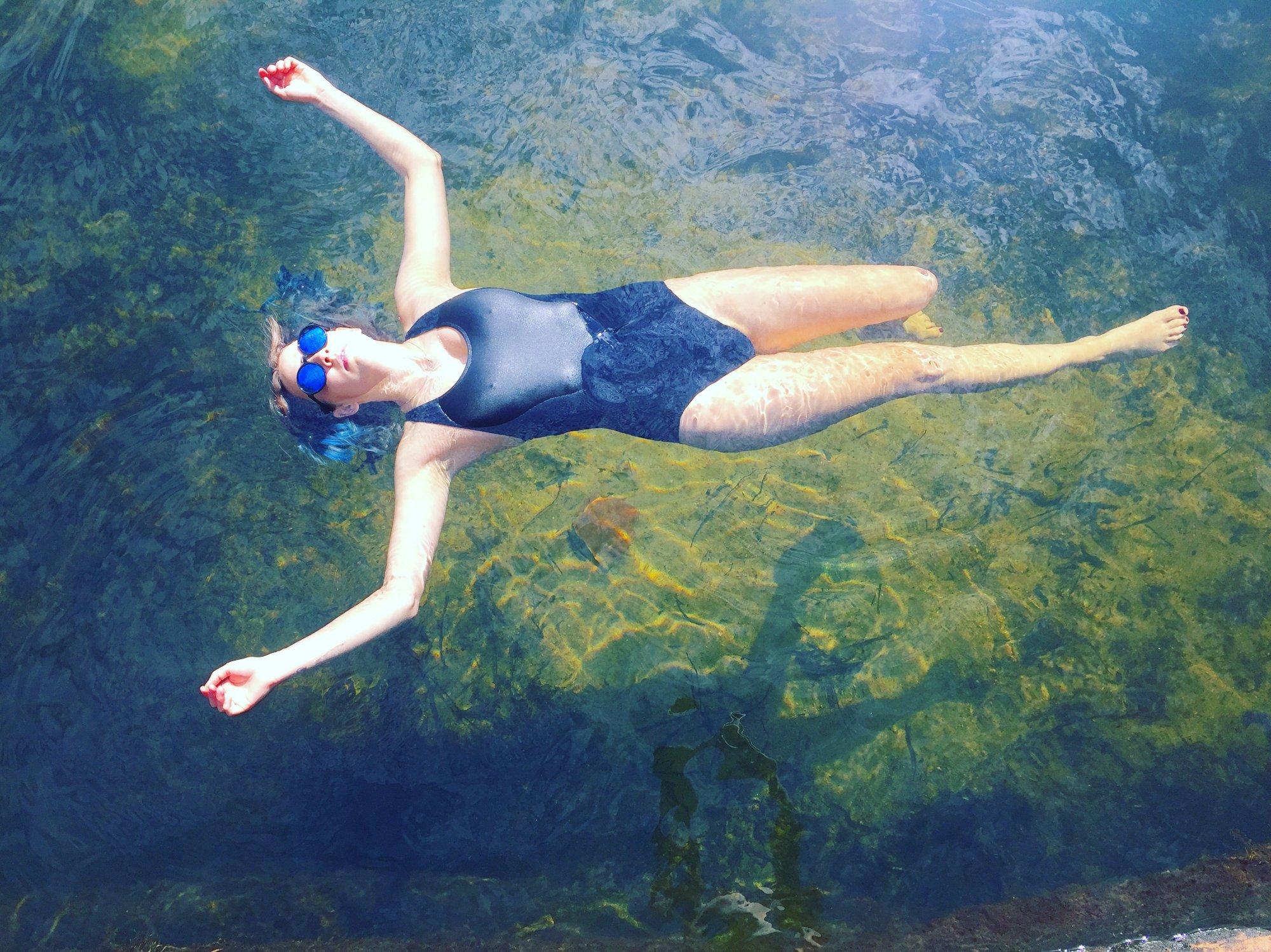 Woman floating in Karloo pools