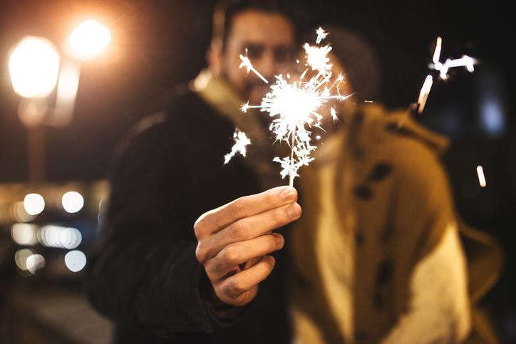 couple holding a sparkler