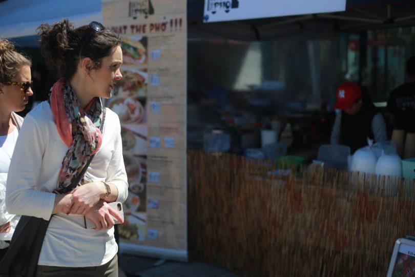 woman looking at stall