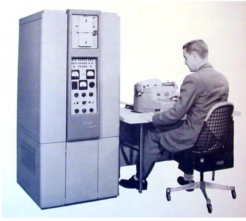 Man sitting at big old computer.