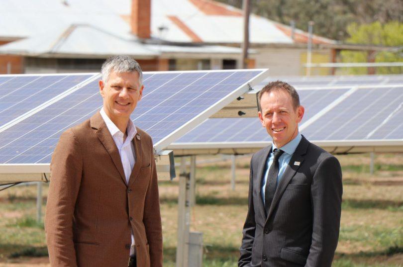2 men and solar panels