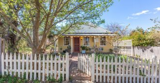 Picture-book period cottage with white picket fence on the market in Braidwood