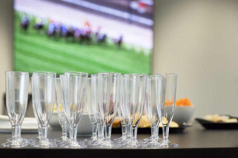 Champagne glasses on bar