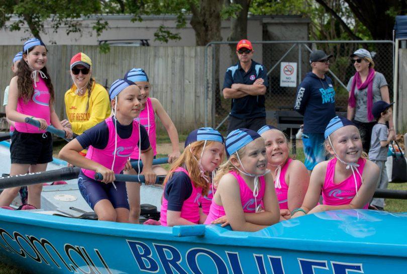 kids in surf boat