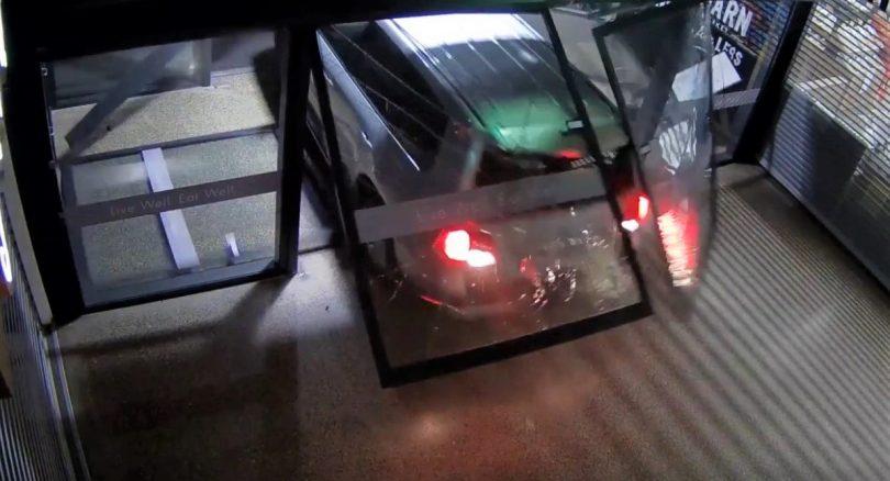 cctv footage of car breaking into shop.