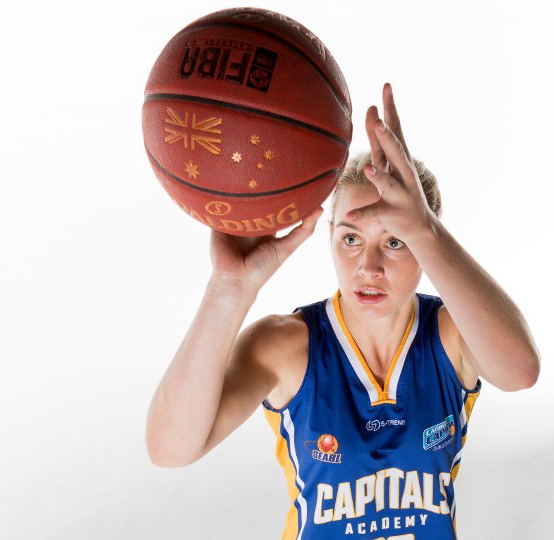 woman playing basketball.