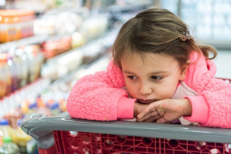girl in supermarket trolley.