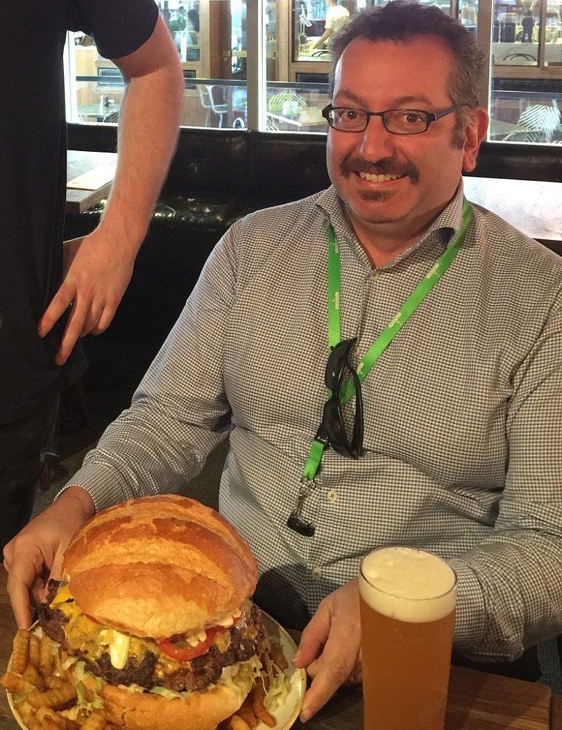 Elias with burger. Photo: JasmineHallaj.