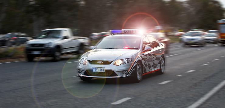 Police car in traffic.