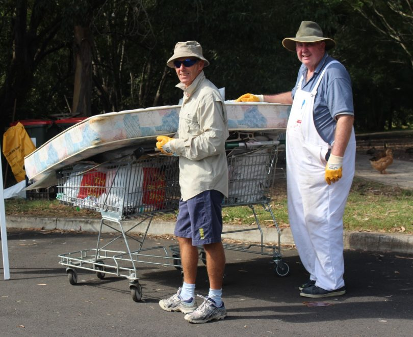 Ron Price and Rob Devanald working hard at the Batemans Bay Water Gardens. Photo: Eurobodalla Shire Council.