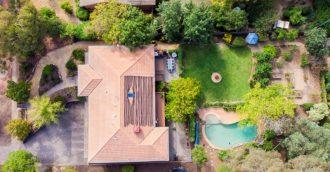 Impressive Weetangera home with resort pool on land    the size of five Gungahlin blocks
