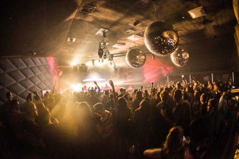 Interior of nightclub, mirror balls hanging from roof