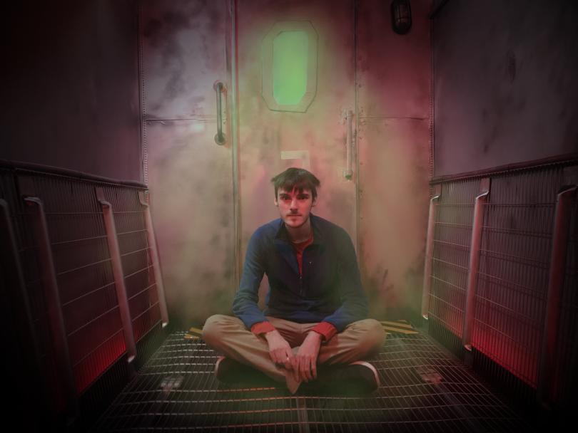Carl Emmerson on the set created for his film, <em>Airlock</em>. Photos: Sanguineti Media
