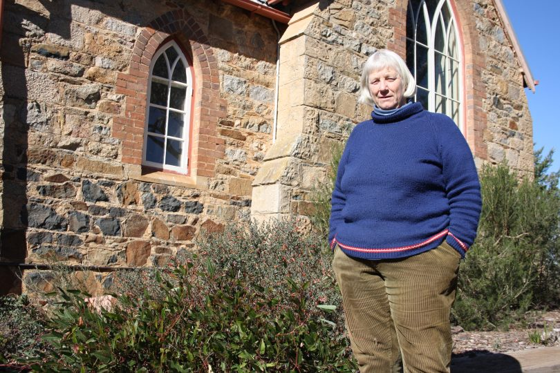 Australian native plant enthusiast Jenny Ashwell, outside the church she converted into a home which is surrounded by her native garden. Photo: Supplied.