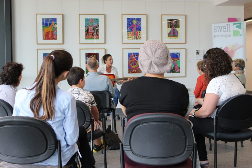 Chelsy Atkins pulled a crowd in April, with Miriam Kidd's art as the backdrop. Photo: Ian Campbell.