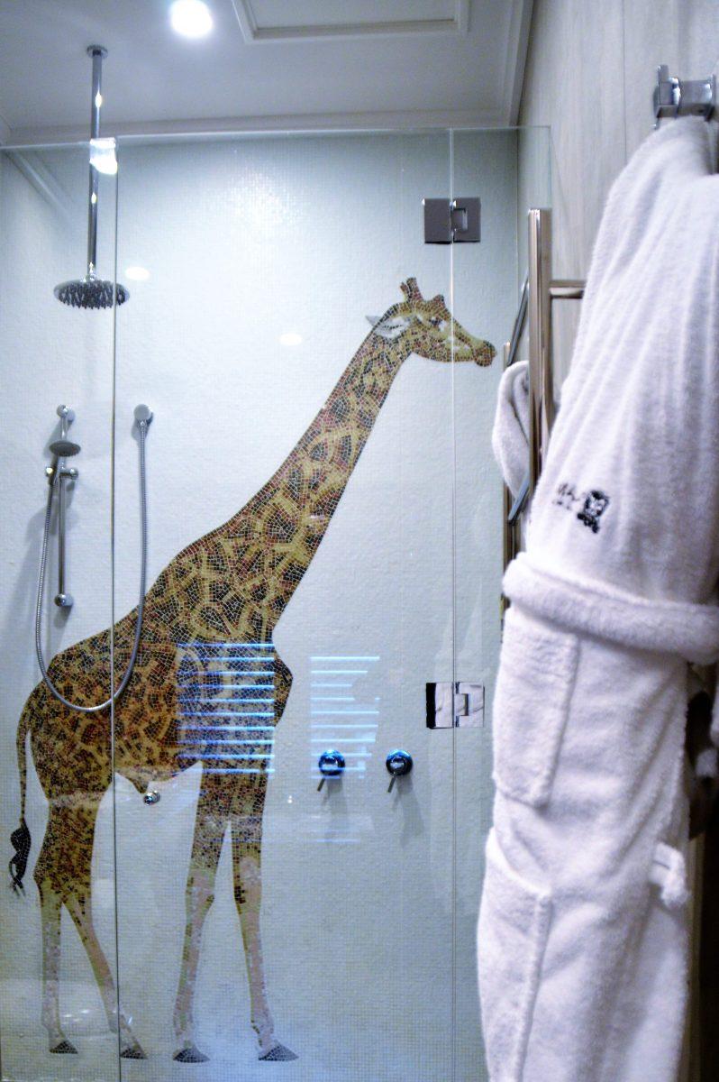 The shower in the giraffe treehouse.