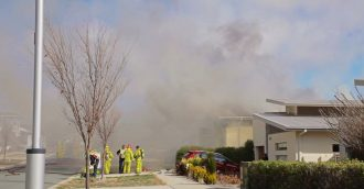 Woman and child hospitalised after fire tears through Crace home