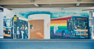 The iconic rainbow ACTION bus features in one mural. Picture: supplied.