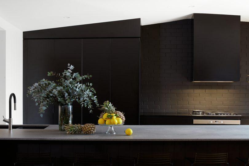 A black modern kitchen.