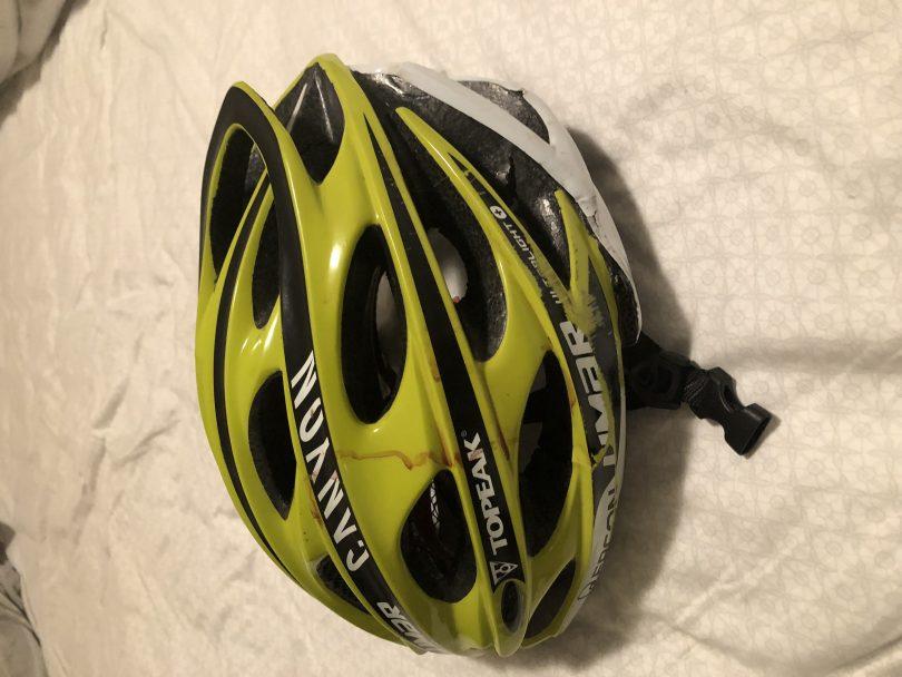 The damaged helmet.