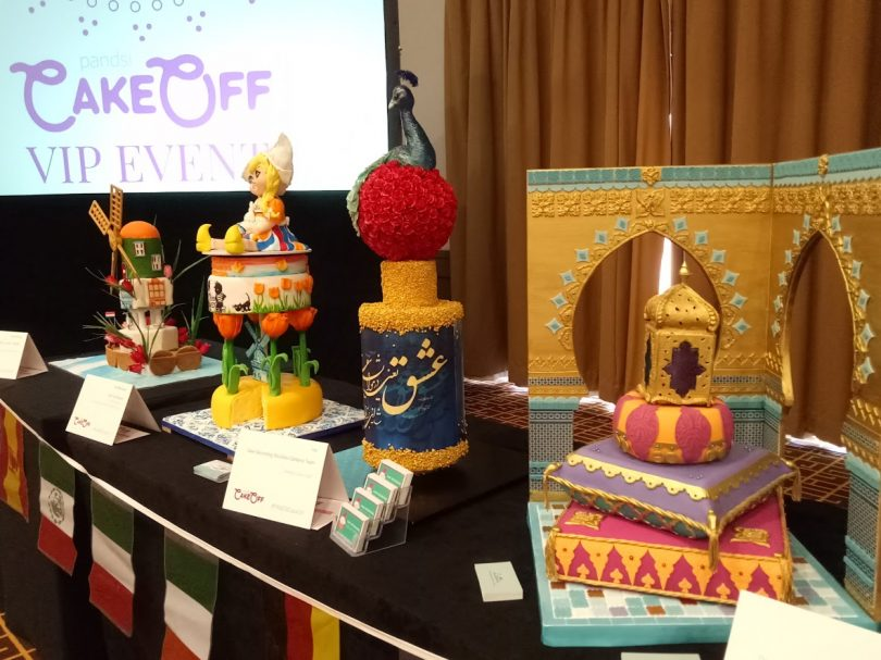 Left to right Two Dutch Windmill cakes - far left by Shane Rattenbury MLA and partner, Iranian peacock and a gold Moroccan lantern with fickering tea light inside