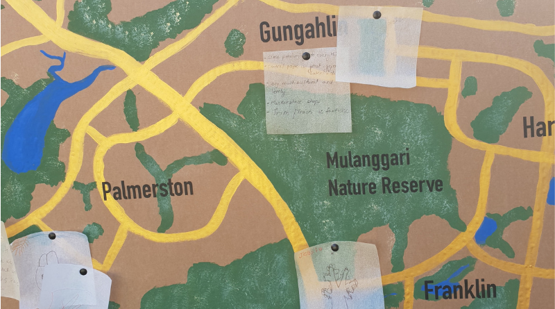 A detail of the Gungahlin Arts Hidden Treasures project, which asks residents to write down what they love about Gungahlin and how the Arts can make it better. Responses are displayed on a large map of the area.