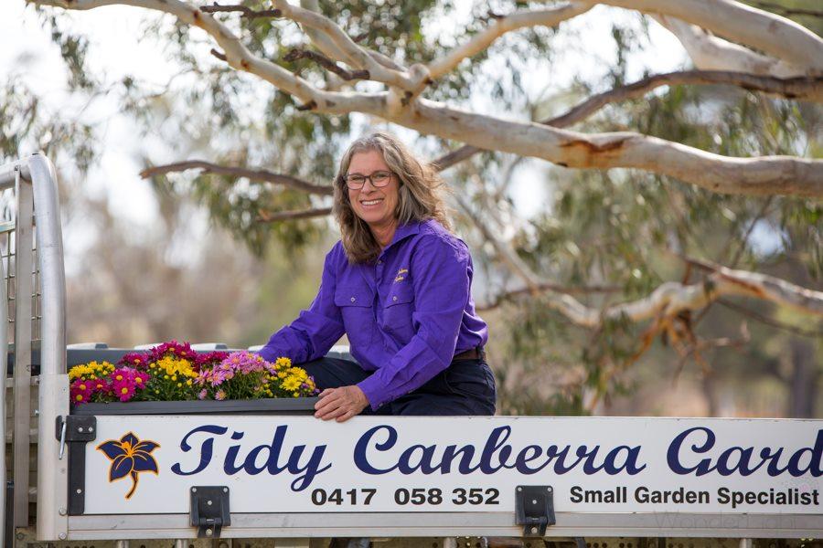Suzie Fletcher working in her business, Tidy Canberra Gardens. Photo: supplied.