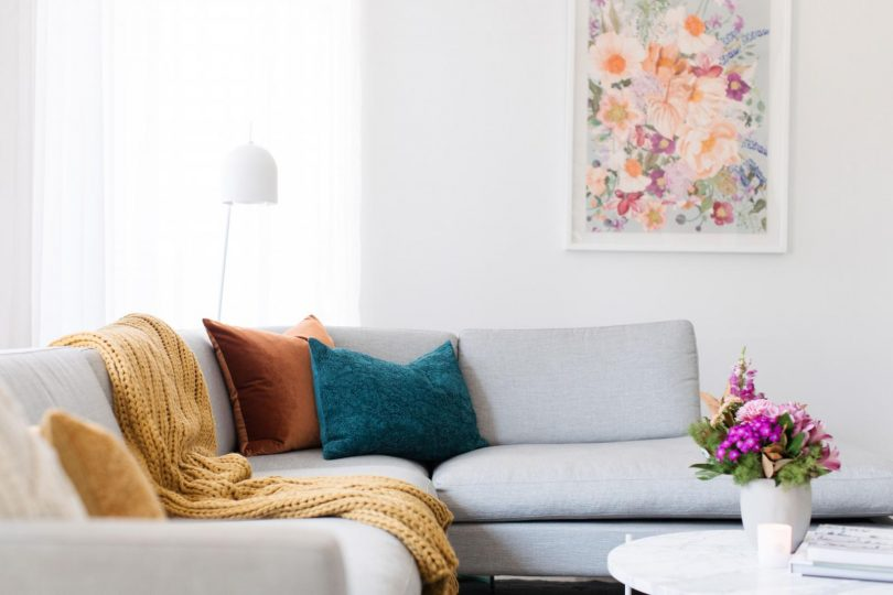 The right artwork will make your living room pop with vitality.