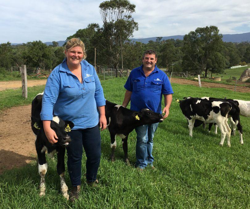 Ashleigh and X Rood with poddy calves on their dairy farm