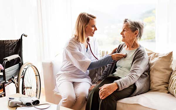 Image of a nurse looking after patient.