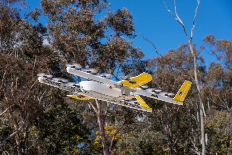 Drone flying above bushland.