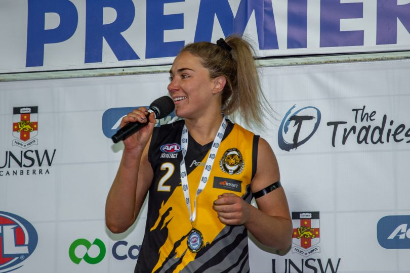 Hannah Dunn with medal, speaking after AFL Canberra grand final.