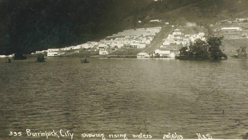 The settlement near rising waters of Burrinjuck Dam.