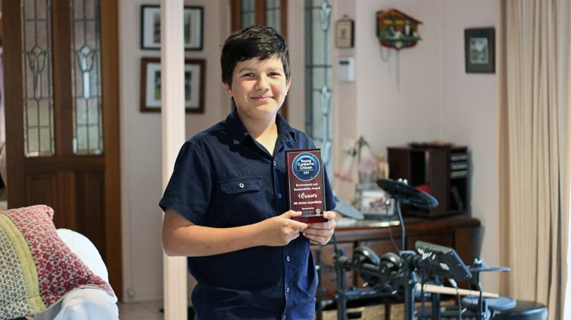 James with his award