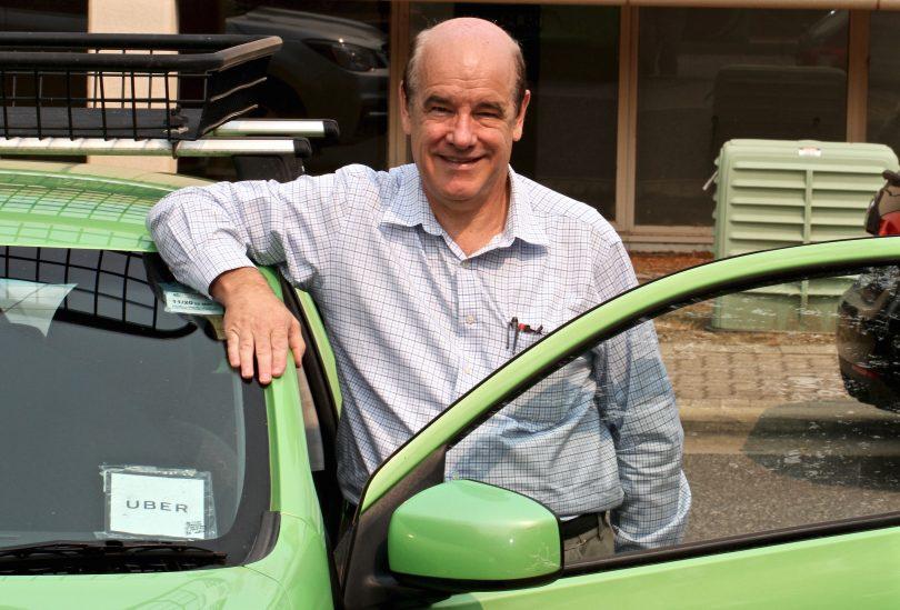 Uber driver John Burge leaning on car