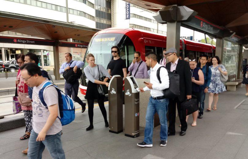 Light rail commuters disembarking in Canberra city.