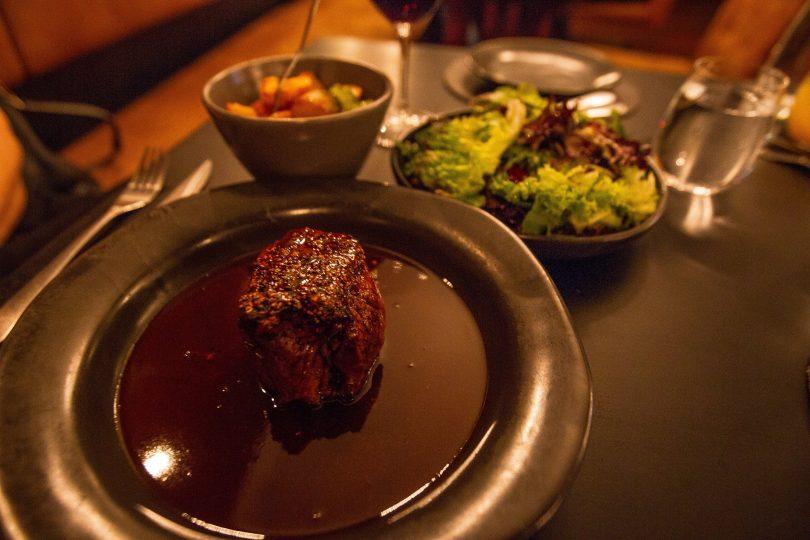 Pepper steak with crispy duck fat potatoes and a fresh garden salad. Photo: Robert Pepper