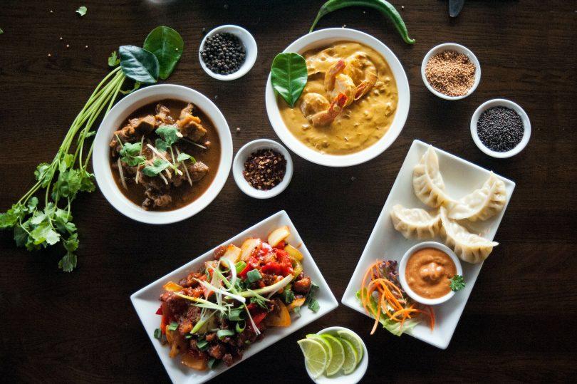 Tiger prawns, chicken dumplings, chicken chilli, and goat curry
