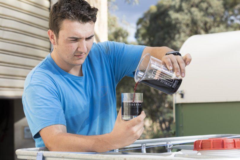 Thomas Darby prepares some merlot wine for distilling